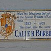 "Bourbon Street, the most famous street in both the French Quarter and New Orleans. As this sign indicates, the ""French"" Quarter was originally a Spanish possession. Old World tile street signs are embedded in the walls of most structures on the corners of the French Quarter."