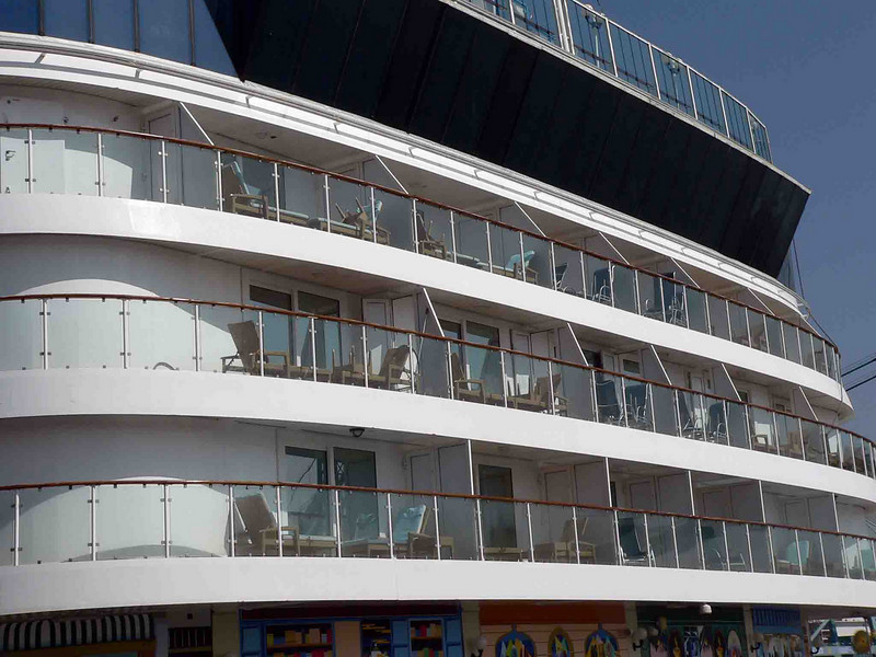 NCL Star aft...our cabin is the 3rd one from the left on the deck under the black glass.