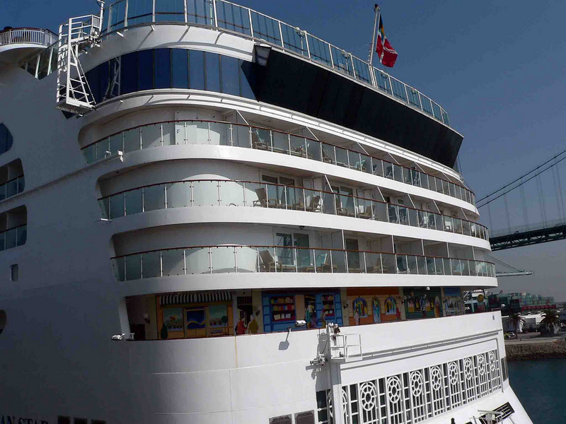 NCL Star aft. Our cabin is right under the flag on the deck under that black glass which is the spa area.