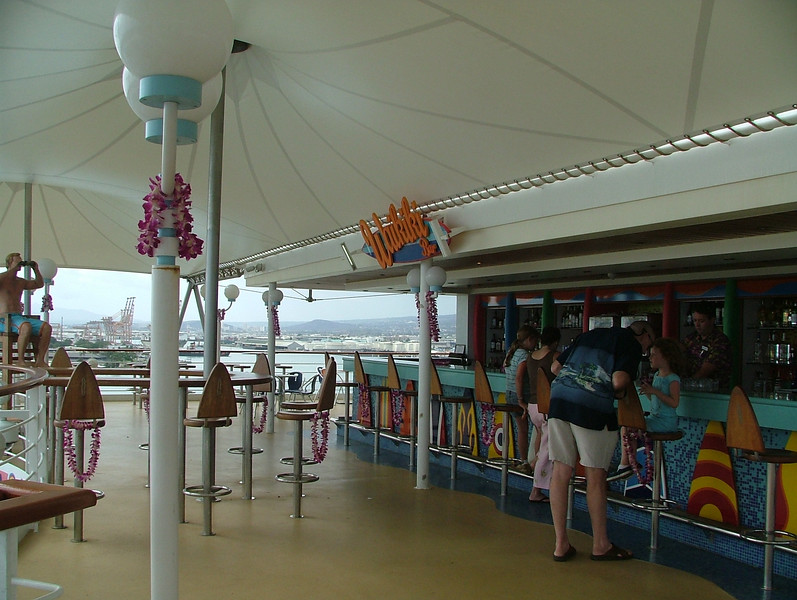 THE WAIKIKI BAR. EVERYONE IS GIVEN A FRESH FLOWER LEI AT  THE SAIL AWAY PARTY ON EMBARKATION.
