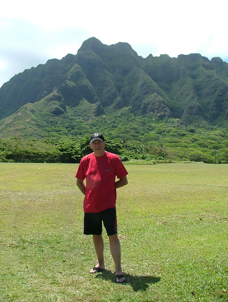 Tony in Oahu, with the beautiful mountains across from the beach.