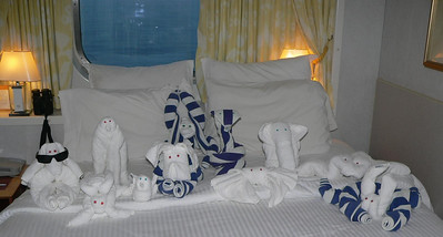 My towel animal menagerie. Dog, sea turtle, penguin, bird, dog, monkey, snake, crab, elephant, stingray, rabbit