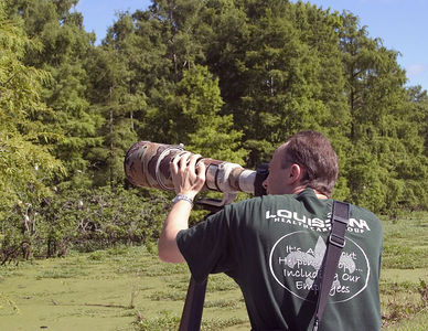 Lake Martin  -- birdwatcher near swamp area