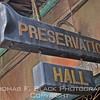 """Sign over entrance to what many consider foremost jazz house in the nation. """"Preservation"""" affixed to outsize trombone case."""