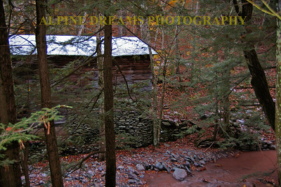 On the upper trail near the pedestrian covered bridge this old mill looks great with a light dusting on the roof. Check out that stone foundation along the muddy brook.