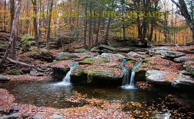 I call this Triple falls       I shot this a couple years back on the Brook same time of year but warm with a light rain. I loved the colors and the soft flowing falls in this particular trip.