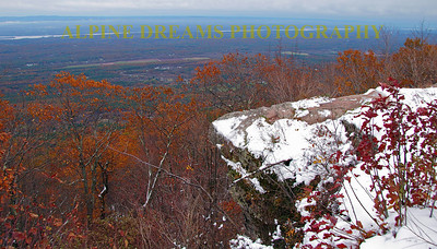 This rock ledge is on the overlook in the Catskills. That is the Hudson River in the background. Back in the 1800's there was a huge Hotel that sat atop this ridge and it was enjoyed by the jet setters of that time period.