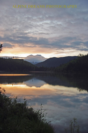 This is Mt Rainier at Dawn as seen from the shore of Mineral lake in Mineral WA. The Mineral lake Inn is a beautifully restored Inn with this view just steps away.  A Must!