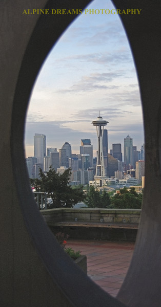 This is one of the shots I got from Kerry park in Seattle. There is a large modern sculpture that served as a perfect frame for the Space Needle at Dawn.