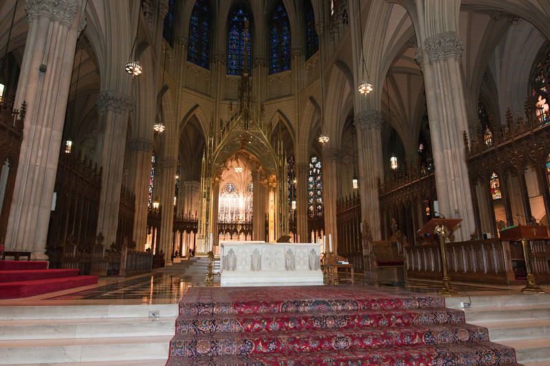 In this view, you see the liturgical altar and the golden canopied sanctuary behind it.  The lighted area at the back is the Lady Chapel.