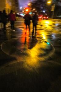 Wet city sidewalks