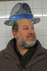 Mosaic hats adorn the 23rd Street subway satation;  Brett's in the Charles Ives fedora.