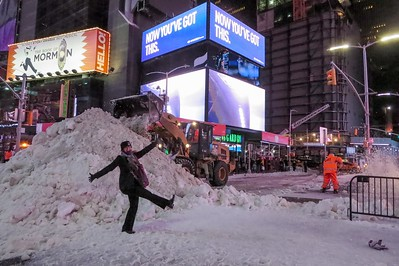 """Hamming it up as Times Square gets cleaned out after Stella dumped about 7"""" of snow. on Tuesday."""