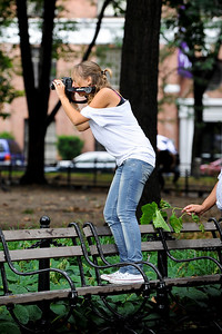 Taking a picture of a girl taking a picture.