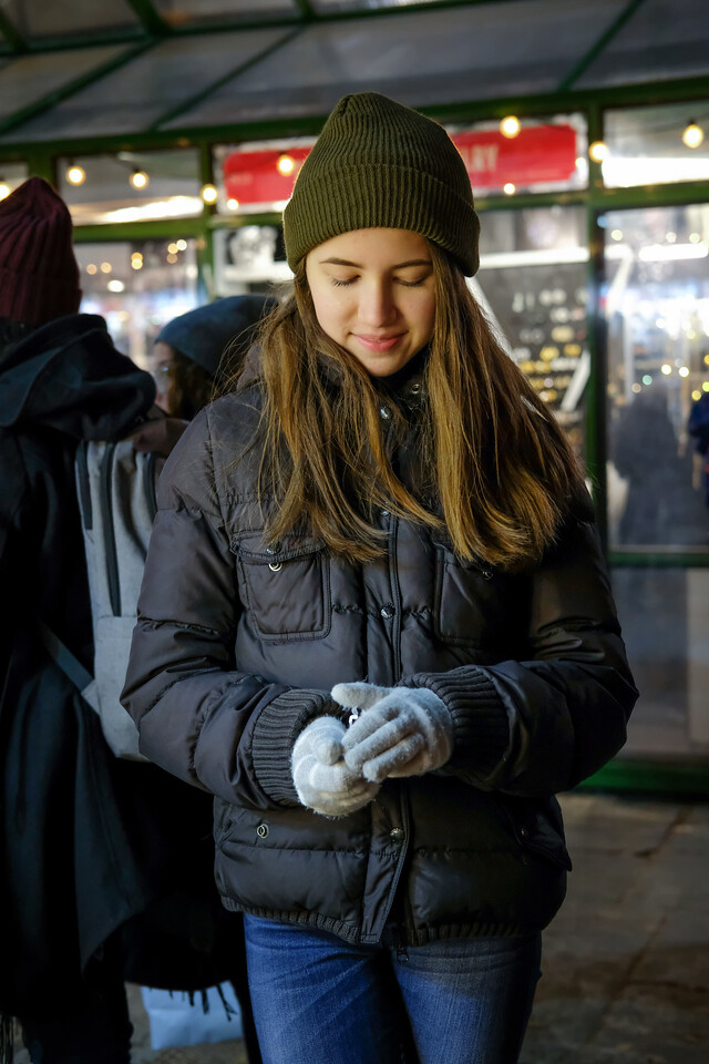 Grace contemplates her handiwork.  She seems pleased  -  Bryant Park Market