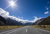 Sun flare on the road to Mt Cook Village, New Zealand