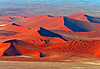 Another highlight of a trip to Namibia is the area of Namib Dunes at Sossusvlei. Their dramatic shapes, colors, shadows, and height inspired multitude of photographs.<br /> <br /> This picture and the next were taken from the air.