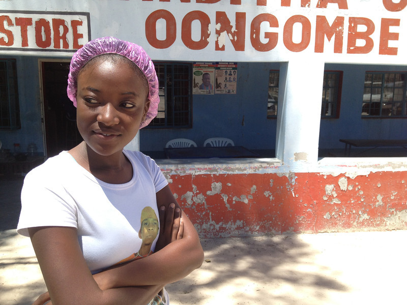 Girl Working at Bottle Store.<br /> <br /> Ondangwa, Namibia.