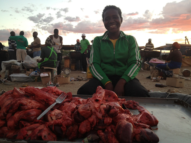 Woman Selling Beef at the Market.<br /> <br /> Katature, Namibia.