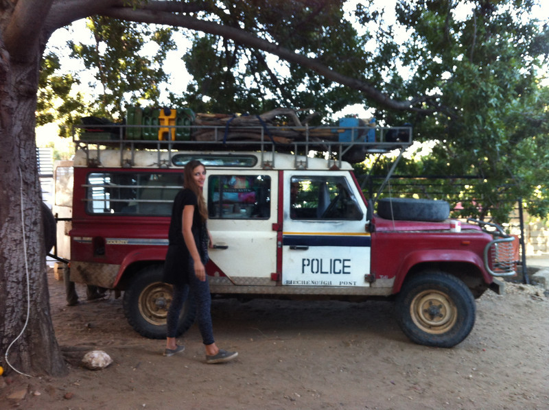 This is Tess...the car. Alki, the woman, stands beside her. The Police door comes from Zimbabwe.