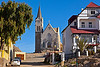 """The seaside town of Luderitz at the Atlantic coast was founded in 1883 as a trading post, but came into prosperity after diamonds were discovered in nearby Kolmanskop in 1909. The town changed very little since then and has many historic buildings, including this """"church on the rocks""""."""