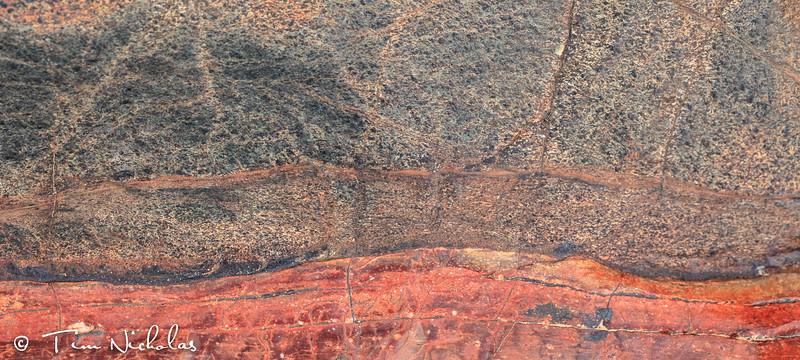 Epupa falls colourful rocks