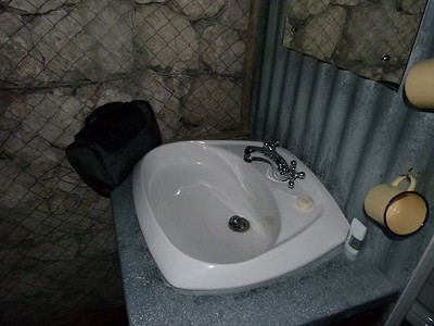 The bathroom.  Notify the wire on the stones to prevent critters from sharing the accommodations.