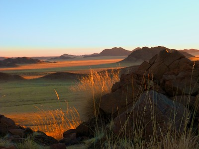 Sossusvlei Dunes at sunset showing reflected light on the grasses.