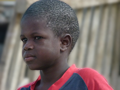 A boy in the township we visited.  The homes are built of cardboard and corrugated metal.