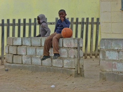 Boys at rest after a vigorous game in the townships outside Swakopmund, Namibia.
