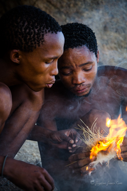 San people in Namibian Desert, teaching how to build a fire using a bird's nest