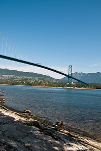 Lion's gate bridge taken from the shoreline at Stanley Park.
