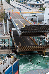 The ramps are raised as the ferry pulls away.