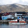 A cruise ship tender boat picks up passengers from the pier at the Port of Nanortalik, Greenland.
