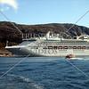 A cruise ship anchored offshore near the port of Nanortalik, Greenland.