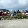 A view of the colorful housing and residential buildings in the town of Nanortalik, Greenland.