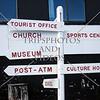 Direction signs at the port of Nanortalik, Greenland.