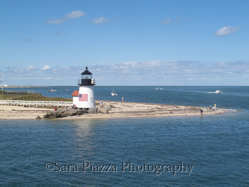 USCG Station Lighthouse at Brant Point, at the entrance to the harbor.