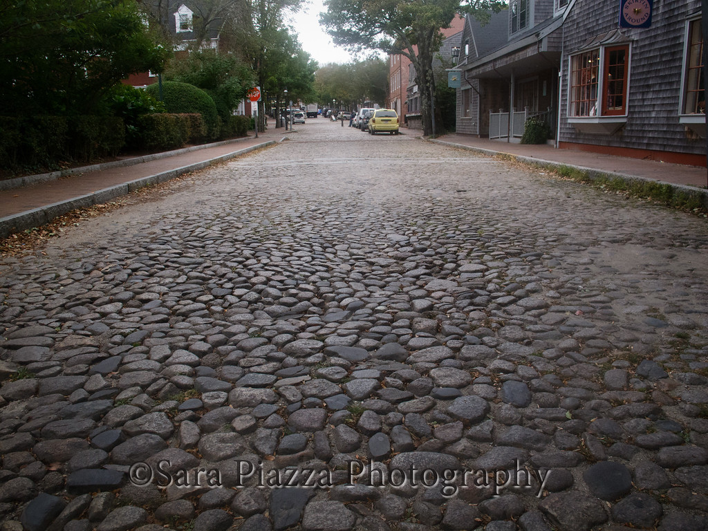 """These cobblestones have the effect of governing the speed of the traffic. Believe me, you do not want to drive fast over these stones - not if you want to keep your teeth. The town is also filled with a constant """"pucketa-pucketa-pucketa"""" sound, as traffic passes by."""