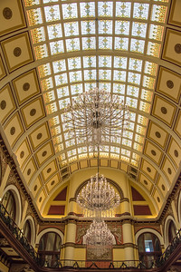 Skylight ceiling and crystal chandeliers over hotel lobby and restaurant