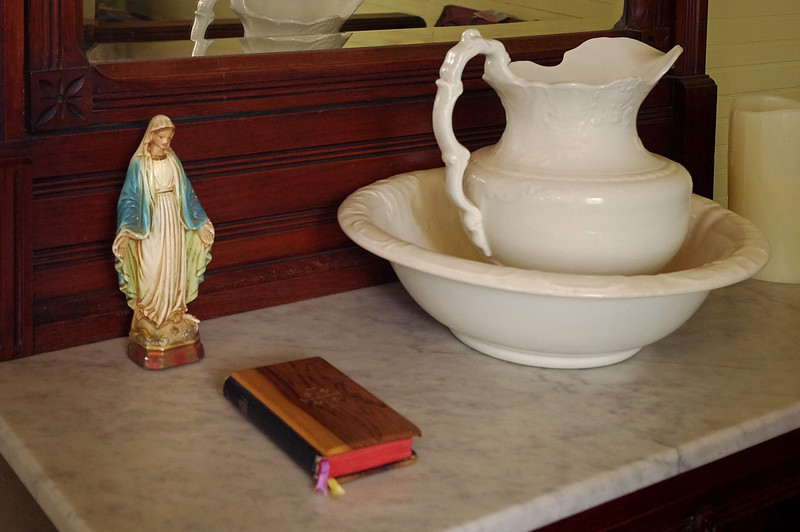 Bedroom detail - Mary, bible and pitcher, Oakland Plantation, near Natchitoches, Louisiana.