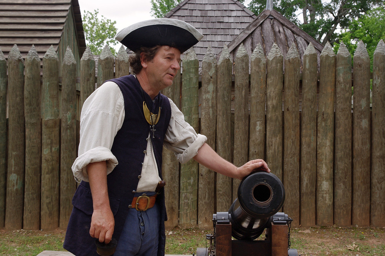 A man and his canon, Fort St. Jean Baptiste State Historic Site, Natchitoches, Louisiana.