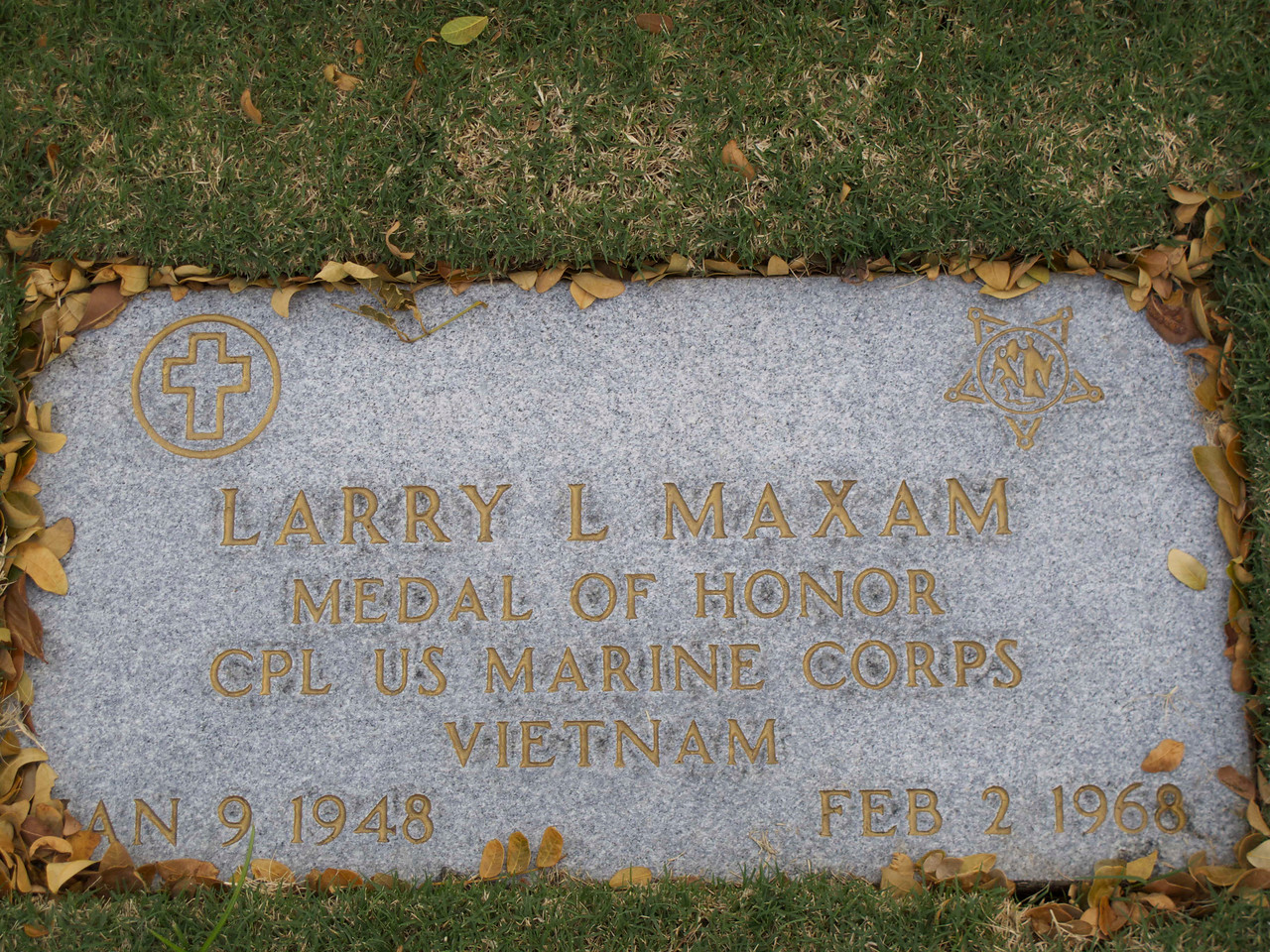 "His citation for the acts which led to his award <a href=""http://en.wikipedia.org/wiki/Larry_L._Maxam#Medal_of_Honor_citation"">is here</a>. He was 20 years old. The symbol at top left is the Christian Cross, and the star on the right is the symbol representing the Medal of Honor."