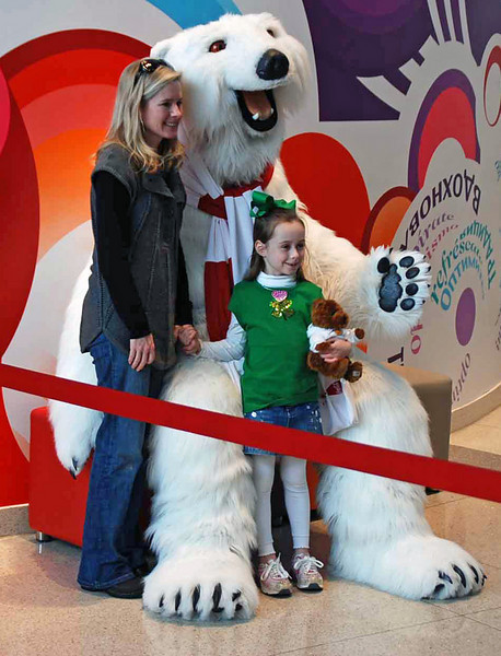 The Coke polar bear poses with museum guests for photos.