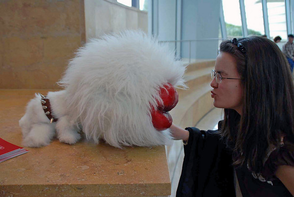 Nina Moiseiwitsch poses with a kissing animal, a character in the 4-D Imax film at the Coke Museum.