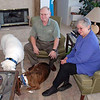David and Edie Finkleman with two of their three dogs in their home in Colorado Springs.