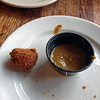 Bacon balls with house cured Berkshire bacon, braised pork shoulder, breaded fried, and served with smoked jalapeno mustard sauce at Knead on High.