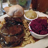 Saurbraten und Gravy with spatzel, red cabbage, potato pancakes, apple sauce, roll & german beer at Schmidt's Sausage Haus.
