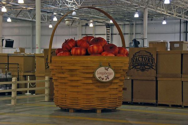 A large basket of apples at the entrance to the Longaberger factory store.