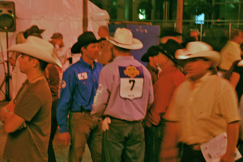 Rodeo competitors gather backstage.